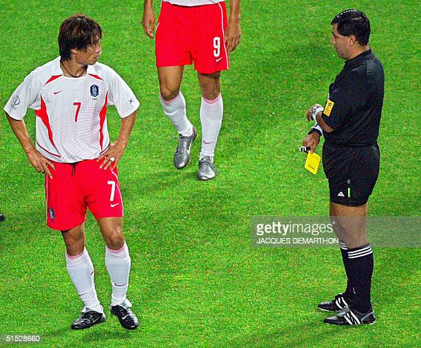 Referee Byron Moreno of Ecuador hands out a yellow card to South Korean defender Kim Tae-young during their second round match against Italy at the...