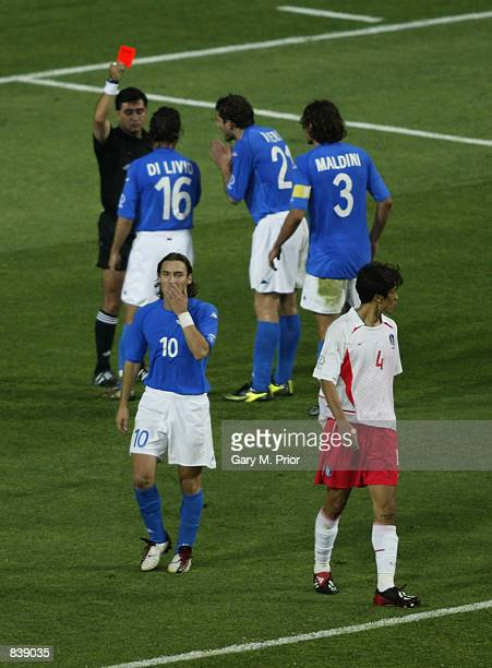 Referee Byron Moreno of Ecuador shows the red card to Francesco Totti of Italy during the FIFA World Cup Finals 2002 Second Round match between South...