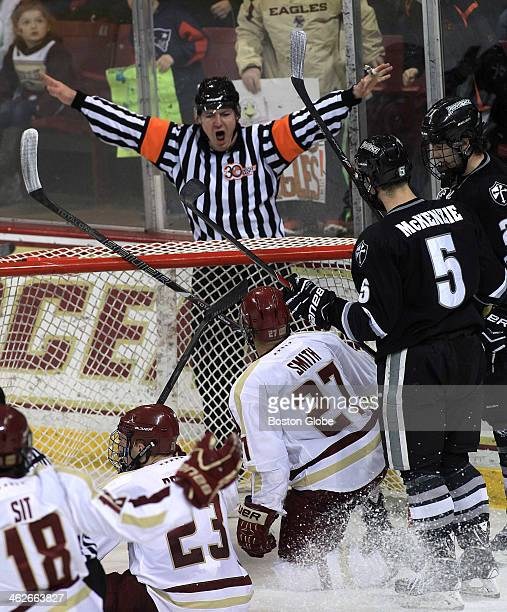 A referee calls a noshot after the goal was moved by the collision of players during a Boston College Eagles vs Providence College Friars at Conte...