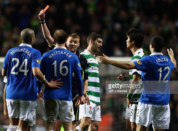 Referee Calum Murray sends off Steven Whittaker of Rangers during the Scottish Cup fifth round match between Celtic and Rangers at Celtic Park on...