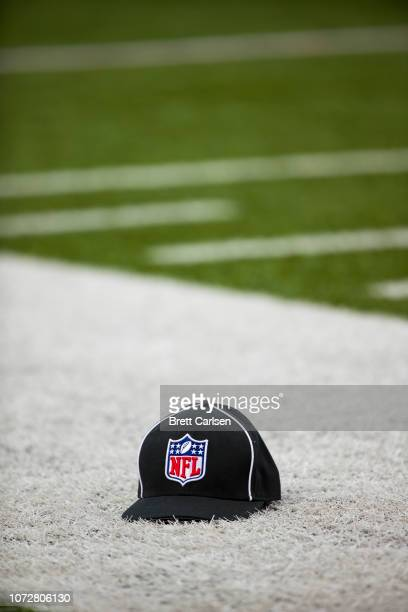 A referee cap with the NFL Shield logo sets on the field's sideline during the game between the Buffalo Bills and the Jacksonville Jaguars at New Era...