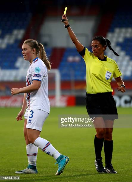 Referee Carina Vitulano of Italy shows the yellow card to Ingibjörg Sigurdardóttir of Iceland during the Group C match between France and Iceland...