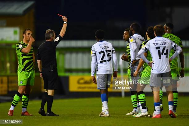 Referee Carl Brook awards Ebou Adams of Forest Green Rovers a red card during the Sky Bet League Two match between Forest Green Rovers and Colchester...