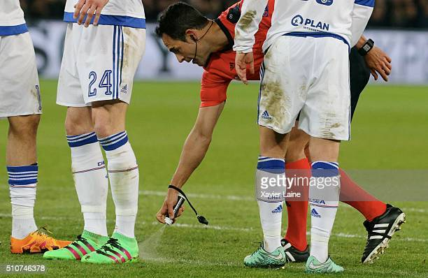 Referee Carlos Carballo spray a line before the goal of Zlatan Ibrahimovic during the UEFA Champions League round of 16 between Paris Saint-Germain...