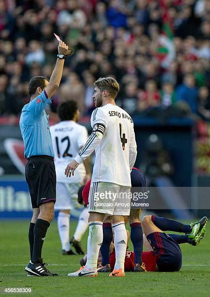 Referee Carlos Clos Gomez shows the red card to Sergio Ramos of Real Madrid CF during the La Liga match between CA Osasuna and Real Madrid CF at...