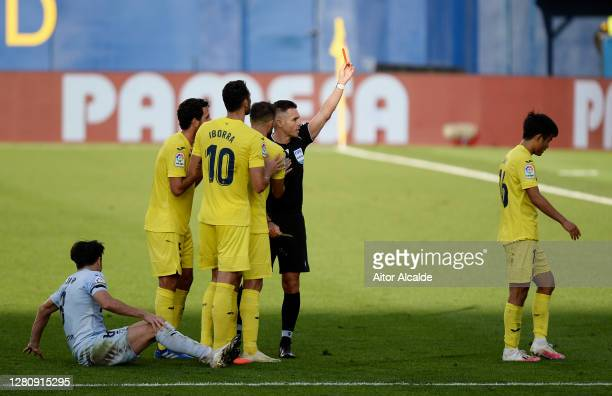 Referee Carlos Del Cerro Grande awards Takefusa Kubo of Villarreal CF a red card during the La Liga Santader match between Villarreal CF and Valencia...