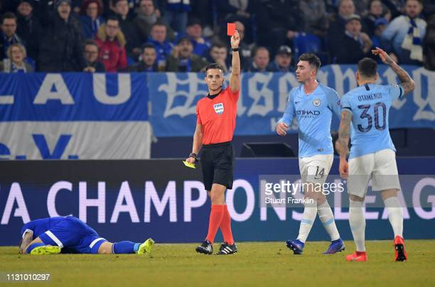 Referee Carlos del Cerro Grande shows the yellow red card to Nicolas Otamendi of Manchester City during the UEFA Champions League Round of 16 First...