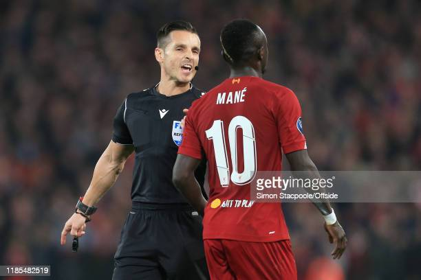 Referee Carlos Del Cerro Grande speaks to Sadio Mane of Liverpool during the UEFA Champions League group E match between Liverpool FC and SSC Napoli...