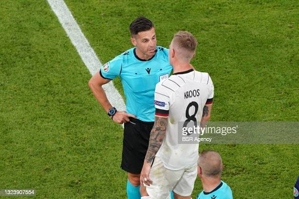 Referee Carlos Del Cerro Grande, Toni Kroos of Germany during the UEFA Euro 2020 match between France and Germany at Allianz Arena on June 15, 2021...