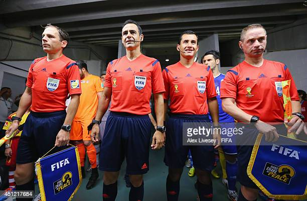 Referee Carlos Velasco Carballo assistant referees and fourth official line up in the tunnel prior to the 2014 FIFA World Cup Brazil Group F match...