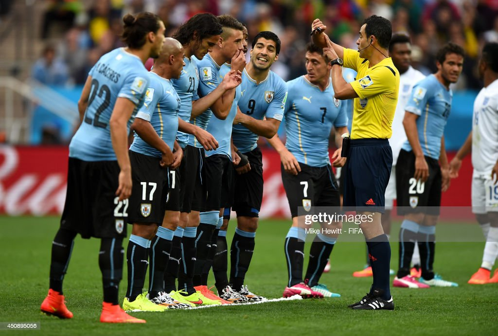 Referee Carlos Velasco Carballo gestures during the 2014 FIFA World Cup Brazil Group D match between Uruguay and England at Arena de Sao Paulo on June 19, 2014 in Sao Paulo, Brazil.