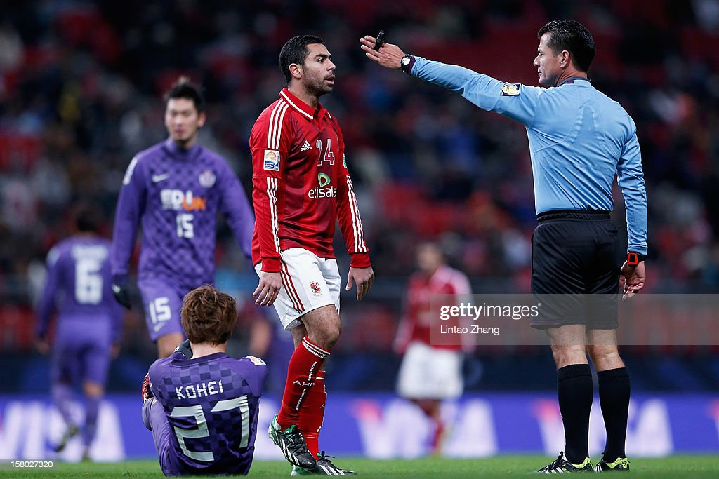 Referee Carlos Vera (R) speaks with Ahmed Fathi during the FIFA Club World Cup Quarter Final match between Sanfrecce Hiroshima and Al-Ahly SC at Toyota Stadium on December 9, 2012 in Toyota, Japan.