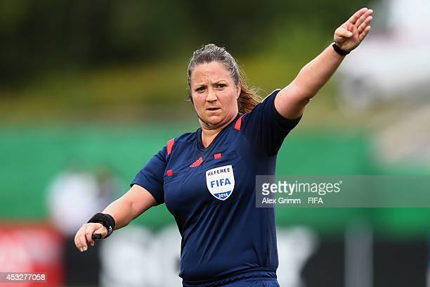 Referee Carol Anne Chenard gestures during the FIFA U20 Women's World Cup Canada 2014 group C match between England and Korea Republic at Moncton...