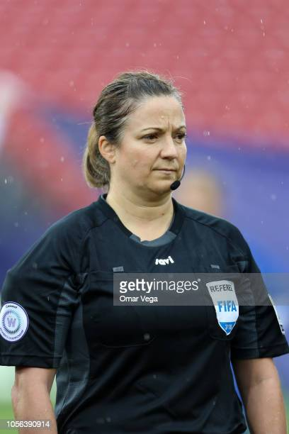 Referee Carol Anne Chénard stands during the National Anthem before the match between Panama and Jamaica as part of CONCACAF Women's Championship at...