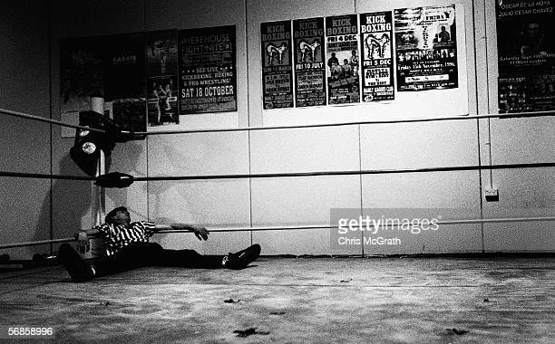 Referee CB Cochran lies passed out in the corner of the ring after a championship bout during the AWF Dojo Wrestling night July 24, 2004 in Sydney,...