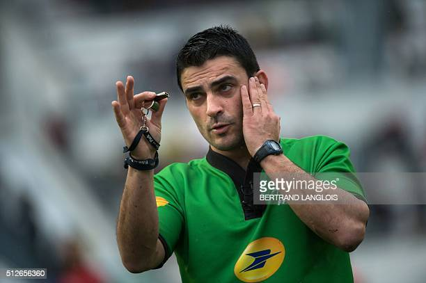 Referee Cedric Marchat gestures during the French Top 14 rugby union match RC Toulon vs Brive on February 27 2016 at the Mayol stadium in Toulon...