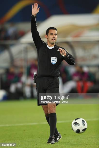 Referee Cesar Ramos of Mexico gestures during the FIFA Club World Cup UAE 2017 final match between Gremio and Real Madrid CF at Zayed Sports City...