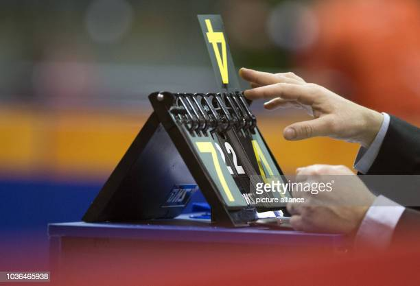 A referee changes the scoreboard after a point during the German Open table tennis qualifiers in Berlin Germany 27 January 2016...