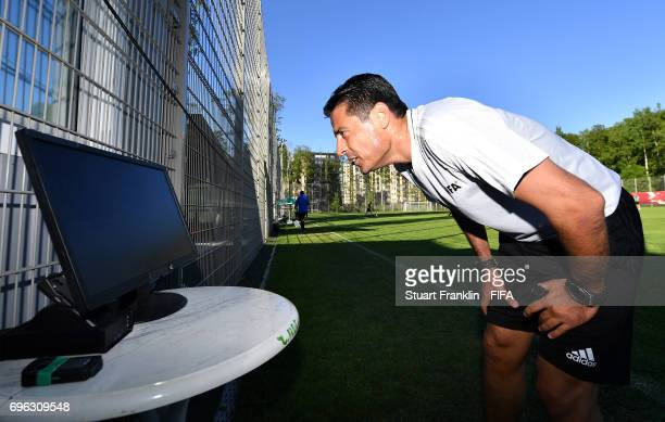 A referee checks a video replay during a training session of Video Assistant Referees on June 15 2017 in St Petersburg Russia