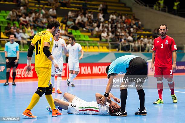 A referee checks upon Ahmad Esmaeilpour of Iran during the FIFA Futsal World Cup Group F match between Azerbaijan and Iran at Coliseo Ivan de Bedout...