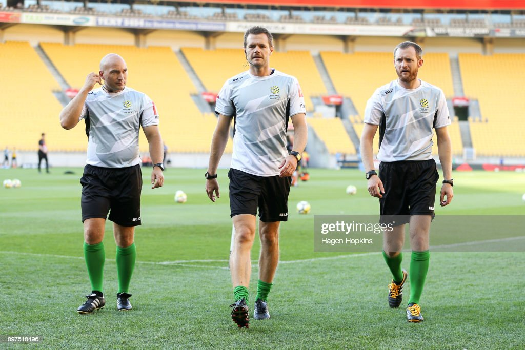 Referee Chris Beath (centre) along with assistant referees Glen Lochrie (L) and Mark Rule leave the field after warming up during the round 12 A-League match between the Wellington Phoenix and Sydney FC at Westpac Stadium on December 23, 2017 in Wellington, New Zealand.