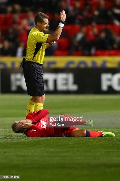 Referee Chris Beath calls for the trainers for Riley McGree of Adelaide during the round 27 ALeague match between Adelaide United and the Western...