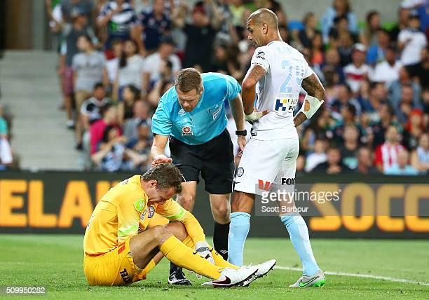 Referee Chris Beath checks on goalkeeper Thomas Sorensen after a free kick from Gui Finkler of the Victory went over the goal line but the goal was...