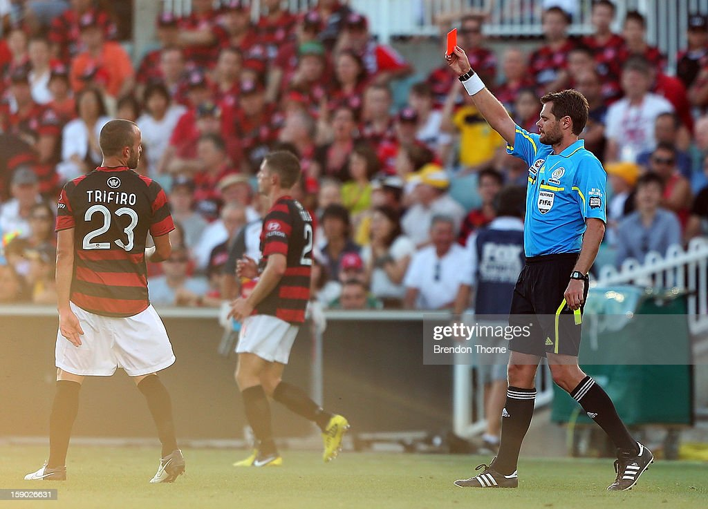 Referee, Chris Beath issues Jason Trifiro of the Wanderers a red card during the round 15 A-League match between the Western Sydney Wanderers and the Central Coast Mariners at Parramatta Stadium on January 6, 2013 in Sydney, Australia.