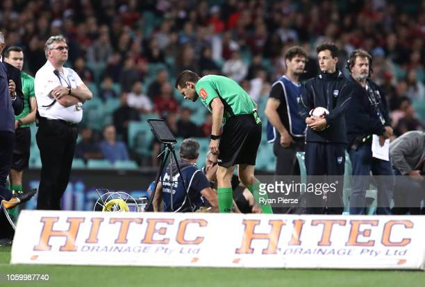 Referee Chris Beath reviews a VAR goal review against the Wanderers during the round two ALeague match between Sydney FC and Western Sydney Wanderers...