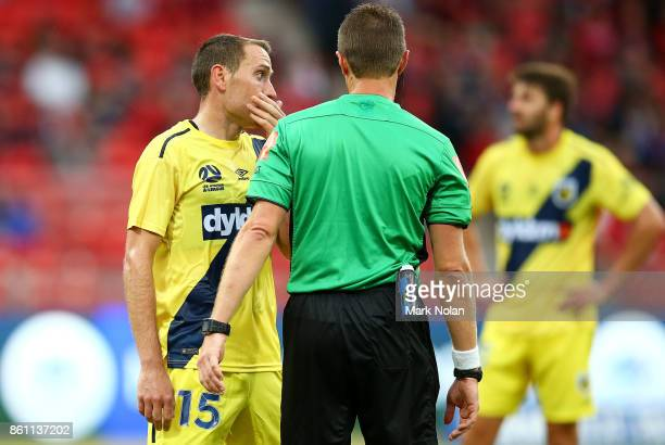 Referee Chris Beath talks with Alan Baro Calabuig of the Mariners after he conceded a penalty kick during the round two ALeague match between the...