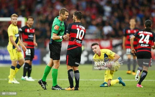 Referee Chris Beath talks with Alvaro Cejudo of the Wanderers during the round two ALeague match between the Western Sydney Wanderers and the Central...