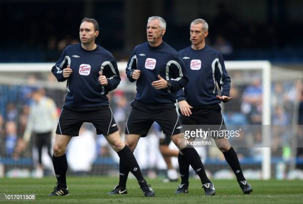 Referee Chris Foy and his two assistants warm up ahead of the Barclays Premier League match between Chelsea and Manchester City at Stamford Bridge on...