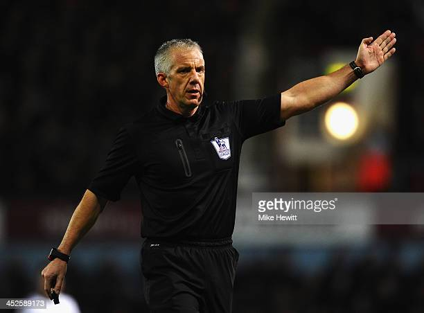 Referee Chris Foy in action during the Barclays Premier League match between West Ham United and Chelsea at Boleyn Ground on November 23 2013 in...