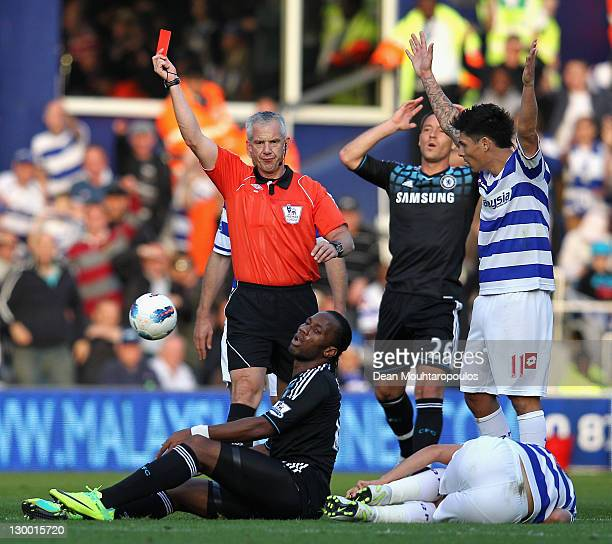 Referee Chris Foy sends off Didier Drogba of Chelsea after a foul on Adel Taarabt of Queens Park Rangers during the Barclays Premier League match...