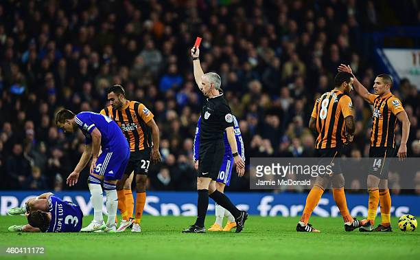 Referee Chris Foy shows a red card to Tom Huddlestone of Hull City after a challenge on Filipe Luis of Chelsea during the Barclays Premier League...