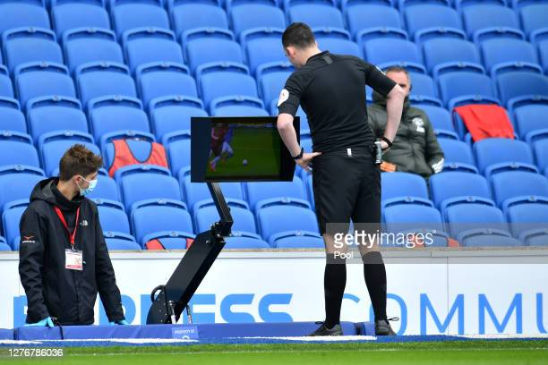 Referee Chris Kavanagh checks the VAR display before deciding to not award Brighton and Hove Albion a penalty during the Premier League match between...