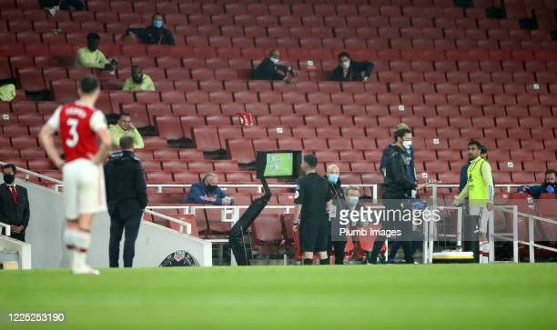 Referee Chris Kavanagh checks the VAR screen before sending off Eddie Nketiah of Arsenal during the Premier League match between Arsenal FC and...