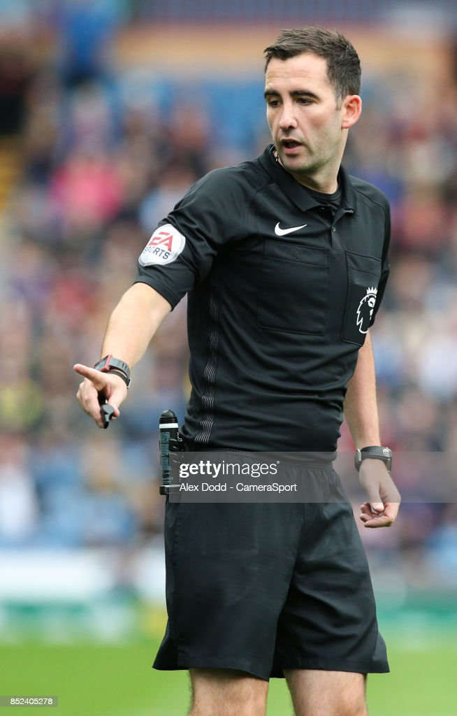 Referee Chris Kavanagh during the Premier League match between Burnley and Huddersfield Town at Turf Moor on September 23, 2017 in Burnley, England.