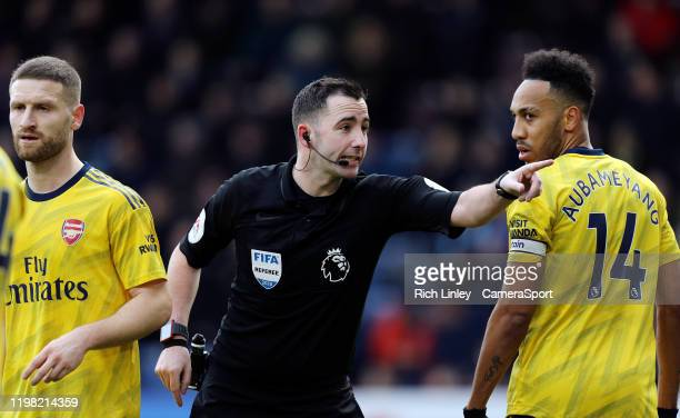 Referee Chris Kavanagh gestures as PierreEmerick Aubameyang looks on during the Premier League match between Burnley FC and Arsenal FC at Turf Moor...