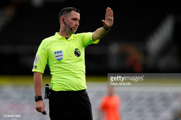 Referee Chris Kavanagh gestures during the English Premier League football match between Fulham and Arsenal at Craven Cottage in London on September...