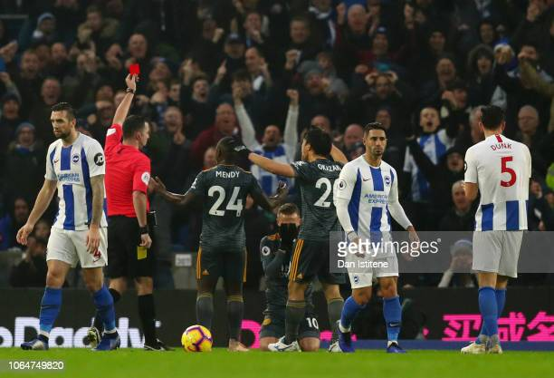 Referee Chris Kavanagh gives a red card to James Maddison of Leicester City during the Premier League match between Brighton Hove Albion and...