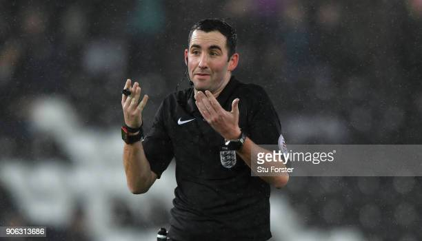 Referee Chris Kavanagh reacts during the Emirates FA Cup third round replay between Swansea City and Wolverhampton Wanderers at Liberty Stadium on...