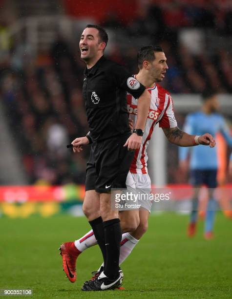 Referee Chris Kavanagh reacts during the Premier League match between Stoke City and Newcastle United at Bet365 Stadium on January 1 2018 in Stoke on...