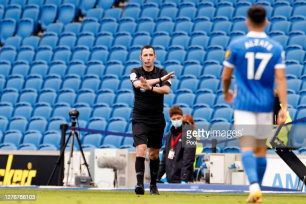 Referee Chris Kavanagh says no penalty for Brighton and Hove Albion after a VAR review during the Premier League match between Brighton & Hove Albion...