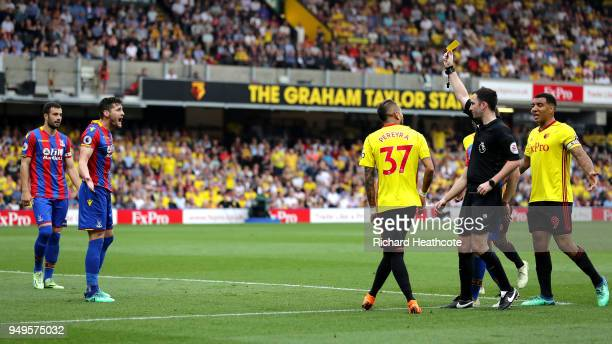Referee Chris Kavanagh shows Joel Ward of Crystal Palace a yellow card during the Premier League match between Watford and Crystal Palace at Vicarage...