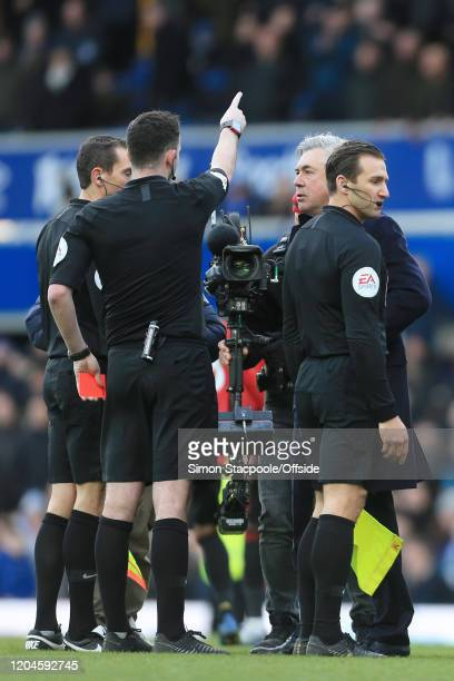 Referee Chris Kavanagh shows the red card and sends off Everton manager Carlo Ancelotti after the Premier League match between Everton FC and...