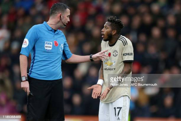 Referee Chris Kavanagh with Fred of Manchester United during the Premier League match between AFC Bournemouth and Manchester United at Vitality...