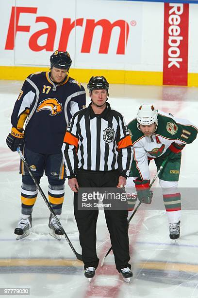 Referee Chris Lee looks on before Raffi Torres of the Buffalo Sabres gets ready to face off against Owen Nolan of the Minnesota Wild at HSBC Arena on...