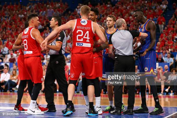 Referee Chris Reid separates Jesse Wagstaff of the Wildcats and Majok Deng of the 36ers during the round 17 NBL match between the Perth Wildcats and...