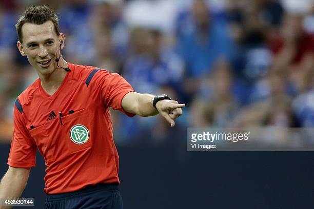 referee Christian Bandurski during the preseason Schalke 04 Cup match between Malaga CF and Newcastle United on August 2 2014 at the Veltins Arena in...